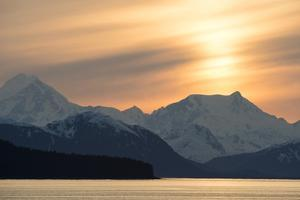 Sunset over Snow-Capped Mountain Peaks in Glacier Bay National Park, Seen from Icy Strait by Jonathan Kingston