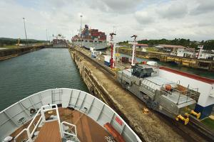The Bow of a Small Passenger Ship as it Transits the Gatun Locks, Guided by a Metal Mule by Jonathan Kingston