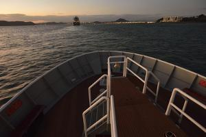 The Bow of a Small Passenger Ship at Sunset as it Enters the Panama Canal by Jonathan Kingston