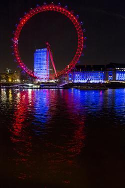 The London Eye, also known as the Millennium Wheel, and the Blue Illuminated County Hall by Jonathan Kingston