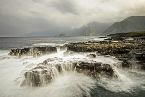 The Pacific Ocean Breaks over the Rocky Shoreline of the Kalaupapa Peninsula by Jonathan Kingston