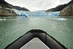 Tourists in an Inflatable Boat in Front of Dawes Glacier by Jonathan Kingston
