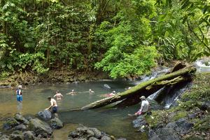 Tourists Swim in a Beautiful Swimming Hole on the Pargo River, Corcovado National Park by Jonathan Kingston
