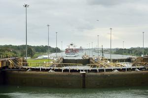 Two Large Container Ships Exit the Gatun Locks on a Overcast Day, in the Panama Canal by Jonathan Kingston