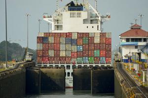 View of the Double Gates of the Gatun Locks Closing Behind a Large Panamax Ship by Jonathan Kingston