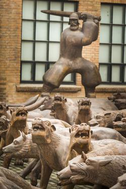 Wolf Sculptures Seemingly Howl Beneath a Swordsman by Jonathan Kingston
