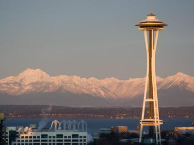 View of the Olympic Mountains and the Space Needle at dawn, Seattle, Washington, USA
