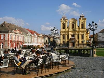 Cafe and Baroque Roman Catholic Cathedral of St George on Piata Unirii