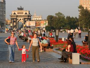 People in Victory Park with Triumphal Arch in Distance, Moscow, Russia by Jonathan Smith