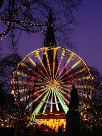 Scott Monument and Christmas Ferris Wheel in Princes Street Gardens, Edinburgh, United Kingdom