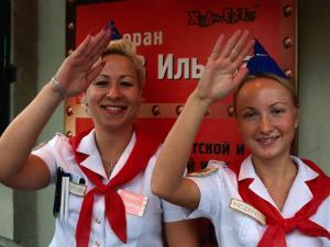Zov Ilycha, Waitresses Dressed as Pioneers at Soviet Themed Restaurant, St. Petersburg, Russia by Jonathan Smith
