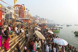 Early Morning Bathers on the Banks of the River Ganges, Varanasi (Benares), Uttar Pradesh, India by Jordan Banks