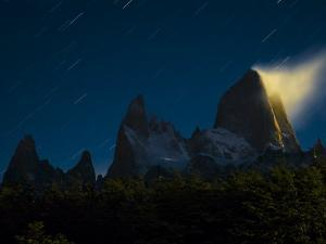 The moon illuminates clouds on Mount Fitz Roy by Jordi Busque