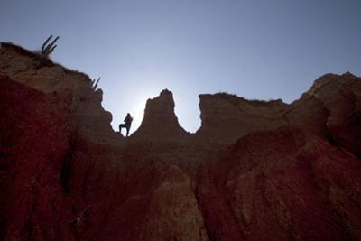 A Hiker Pauses on a Mountain in the El Cuzco Region of the Tatacoa Desert in Southwest Colombia
