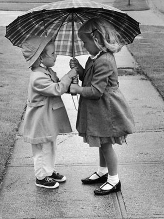 Girls Sharing an Umbrella