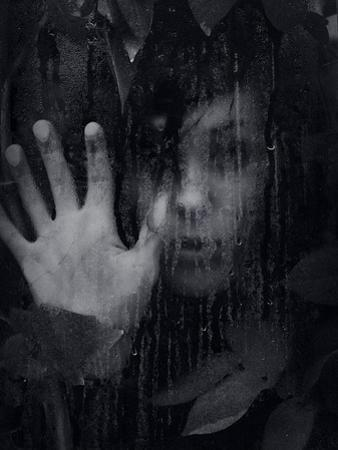 Female Youth Hidden Behind Glass