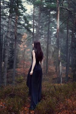 Young Woman Wearing Black Dress in Woods by Josefine Jonsson