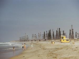 Beach Scene with Oil Rigs in the Background by Joseph Baylor Roberts