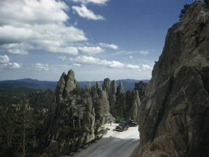 Cars Park in Overlook Beside Rock Formations Lining Needles Highway by Joseph Baylor Roberts