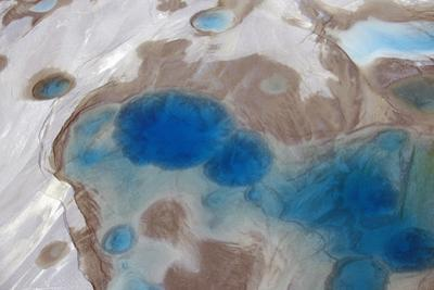 Aerial View of Silt and Turquoise Water in an Alaska Glacier, Alaska by Joseph Sohm