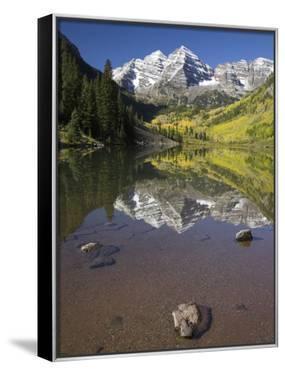 Aspens reflecting in lake under Maroon Bells, Colorado by Joseph Sohm