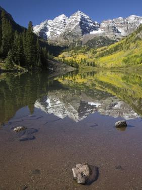 Aspens reflecting in lake under Maroon Bells, Colorado by Joseph Sohm