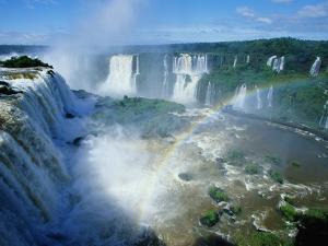 Iguazu Waterfalls and Rainbow. by Joseph Sohm