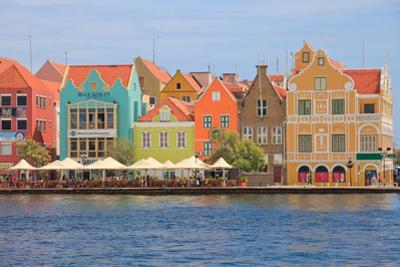 Colorful Colonial Houses in Willemstad, Curacao in the Caribbean by juancat