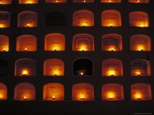 Candles Light the Graves of Niches in the Cemetary, Oaxaca, Mexico by Judith Haden