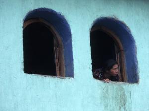 Woman Looking Out of Window, Chichicastenango, Guatemala by Judith Haden