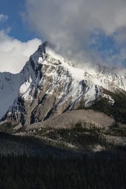 Canada, Alberta. Leah Peak, with snow and clouds, Maligne Lake, Jasper National Park. by Judith Zimmerman