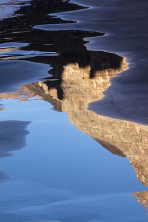 USA, Arizona. Canyon wall reflections on a sand beach, Grand Canyon National Park.