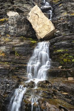 USA, Montana. Boulder and waterfall in Glacier National Park. by Judith Zimmerman