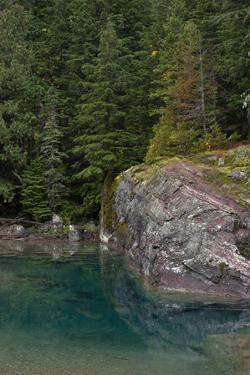 USA, Montana. Rocky outcrop, McDonald Creek, Glacier National Park. by Judith Zimmerman