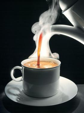 Coffee Being Poured into a Cup by Jürgen Klemme