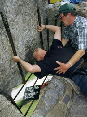 Kissing the Blarney Stone, County Cork, Munster, Eire (Republic of Ireland) by Julia Bayne