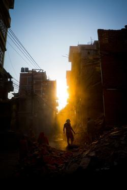 Rays of early evening sun on the dusty streets of Thamel after earthquake, Kathmandu, Nepal, Asia by Julian Bound
