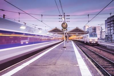 A TGV high speed train leaves the train station in Tours, Indre et Loire, Centre, France, Europe by Julian Elliott