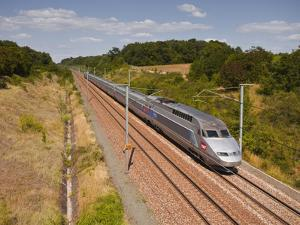 A Tgv Train Speeds Through the French Countryside Near to Tours, Indre-Et-Loire, Centre, France, Eu by Julian Elliott