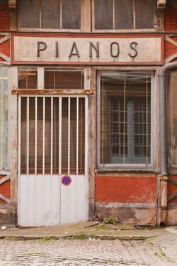 An Old Piano Store in the City of Dijon, Burgundy, France, Europe by Julian Elliott
