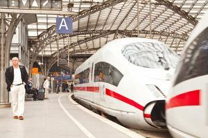 Passengers Waiting to Board a Highspeed Ice Train in Cologne Railway Station by Julian Elliott