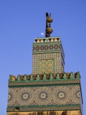 A Minaret with the Early Moon in the Background; Old Medina in Fes, Morocco by Julian Love