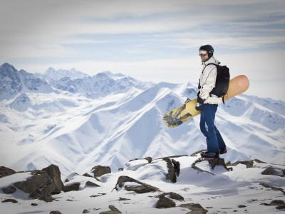 A Snowboarder at the Summit of Mount Affawat in Gulmarg, Kashmir, India