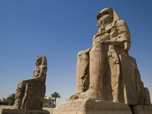 Colossi of Memnon Stand at Entrance to the Ancient Theban Necropolis on West Bank of Nile at Luxor by Julian Love