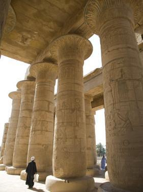 Man Walks Underneath the Giant Columns of the Hypostyle Hall in the Ramesseum, Luxor by Julian Love
