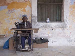 Man Works His Sewing Machine on Ibo Island, Part of the Quirimbas Archipelago, Mozambique by Julian Love