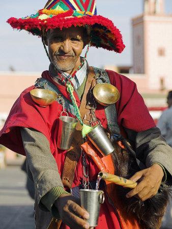 Moroccan Water Seller in Traditional Dress in the Djemaa El Fna, Marrakech
