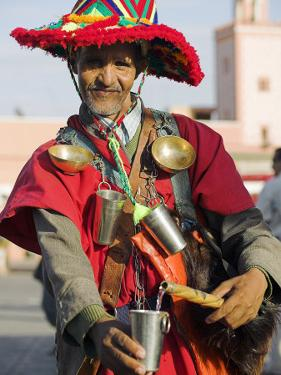 Moroccan Water Seller in Traditional Dress in the Djemaa El Fna, Marrakech by Julian Love