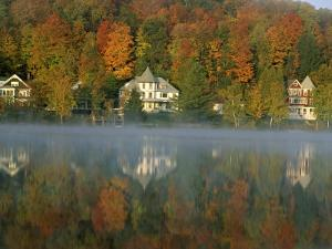 Large Houses Beside Lake Flower at Saranac Lake Town in Early Morning, New York State, USA by Julian Pottage