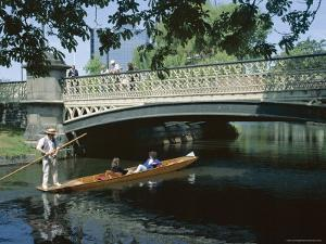 Punt on River Avon Going Under Bridge, Christchurch, Canterbury, South Island, New Zealand by Julian Pottage